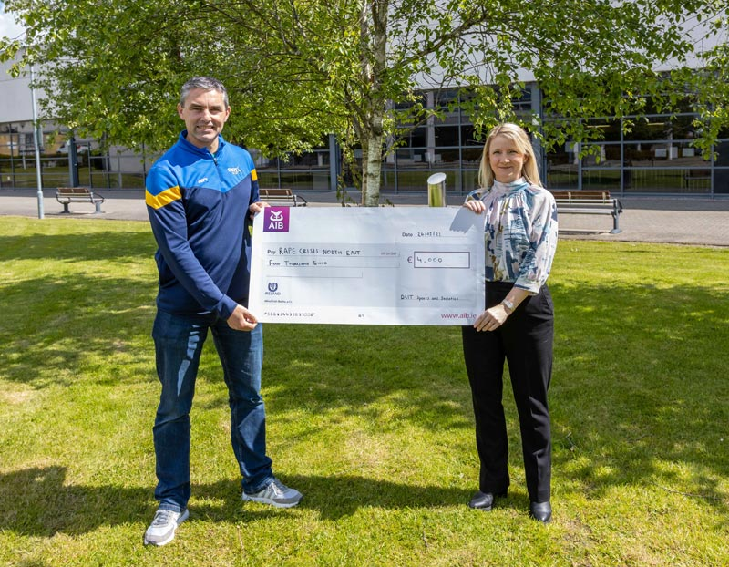 Grace McArdle and Graham Clarke following the presentation of a cheque for €4000 raised by the DkIT Virtual Run 2021 for Rape Crisis North East.