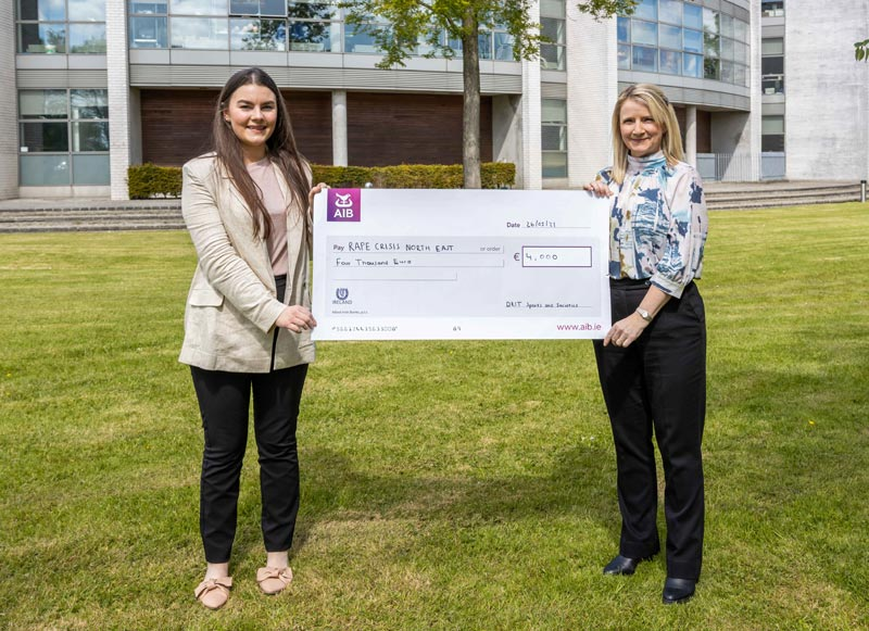 Grace McArdle and Katisha Kiernan following the presentation of a cheque for €4000 raised by the DkIT Virtual Run 2021 for Rape Crisis North East.